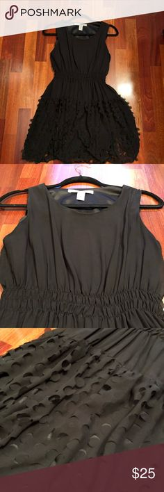 American Rag Black 3D Dress - Size M American Rag Black 3D Dress - Size M. Standard tank top with flowy skirt with 3D pieces. Very cool piece. This is a size medium juniors and I think it fits more like a XS/S. American Rag Dresses Mini
