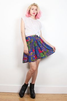 Vintage skirt. Abstract print. Elastic waist back. Pockets. Hemmed mini length. Unlined. *pinned on model to show fit. Shoulder Width:  Bust:  Waist: 33-40 Hips: 54 Length: 17.5 Tag: Norton McNaughton. 18w. 100% rayon Fits Like: XL  Accessories are not included unless listed in the item description For reference the model is 57, and a US size 2.     **PAYMENT/ SHIPPING/ REFUNDS/ SIZING: Please review my shop policies before buying. Thank you…