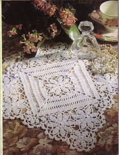 Square lace crochet mat with 8-petal flower motifs