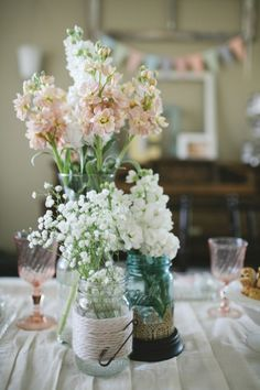 Rustic, robbins egg blue tinted mason jars for vases. babys breath and light pink roses