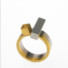 PHOEBE PORTER | Regram from @bilkgallery - Pair of rings from my current exhibition Cubist ring / 750 gold and Cantilever ring / stainless steel. #unfoldandconstructexhibition #phoebeporter #stackring #gold #ring #engagementring #stainlesssteel #phoebeporter