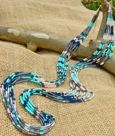 Seed bead multi strand patterned statement necklace. Mint, dark blue, grey, peach, purple. Southwest style