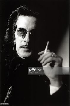 Willy DeVille of Mink DeVille, portrait, holding a cigarette, at The Grand Hotel, Amsterdam, Netherlands, 9th October 1995.