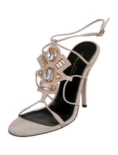 Pale pink suede Oscar de la Renta sandals with jewel embellishments at tops, covered heels and buckle closures at ankles.