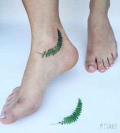 Fern tattoo on ankle by Pis Saro