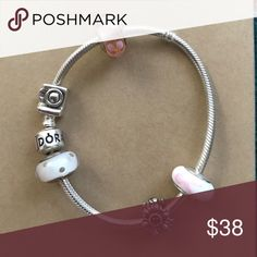 Like new silver pandora bracelet Will sell with charms or without- please inquire. Worn once!!! Pandora Jewelry Bracelets