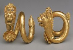 Gold and copper alloy spiral earrings with lion-griffin head terminal  Greek or Cypriot, 1st half of the 4th century B.C. (Classical period)