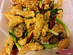 Cambodian food recipe dishes fried bumborng, fried calamari squid with garlic and peppers