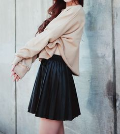 I really like this outfit with the creme sweater with the black skirt.
