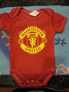 Dyed red onsie with heat vinyl Manchester united