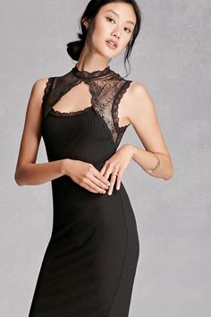 A ribbed knit bodycon dress by Rehab™ featuring a sleeveless cut, lace panels along the shoulders, a high scalloped neckline, front and back cutouts, and a concealed back zipper.