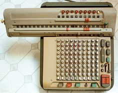 Monroe calculator 1960 - electric but also with manual devices such as an exposed operating crank and a manual carriage position crank