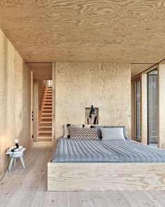 The Success of Andreas Martin-Löf's House Near Stockholm Lies in Being Playful and Taking Risks - - In the bedroom, a custom sconce illuminates pillows by Anna Sörensson. Photography by James Silverman. Interior Design Magazine, Home Interior Design, Plywood House, Plywood Walls, Wooden Architecture, Interior Architecture, Plywood Design, Plywood Interior, Treatment Rooms