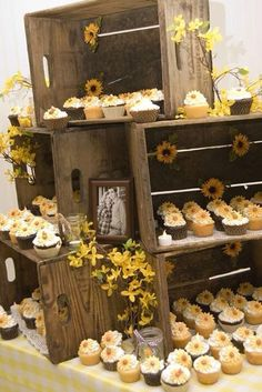 Love cupcakes for a wedding cake. I also love he incredible way to use apple crates!!