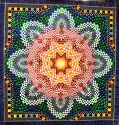 Wow... I wonder how many pieces are in this awesome quilt.  It looks like a kaleidoscope vision!