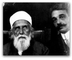 Howard Colby Ives (right) seated with 'Abdu'l-Bahá at a meeting in 1912.