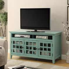 Shelf Thickness: Riverbay Furniture TV Stand in Distressed Antique Turquoise. Perfect for placing in a living room or bedroom, the cabinet features three doors, interior shelf and a glass front. My Living Room, Living Room Furniture, Living Room Decor, Blue Tv Stand, Tv Cabinets, Repurposed Furniture, Furniture Ideas, Furniture Logo, Refurbished Furniture