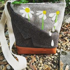 This absolutely adorable bag has been hand felted by me and sewn together by my best friend Lynette.  Made from old wool suits this bag is so much fun. It is currently available in her Etsy shop.  Check it out by clicking this link!