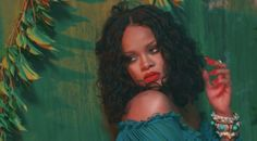 rihanna wild thoughts make up look -aquamarine cat eye,black eye liner and a red lip <3