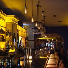 We developed bespoke fittings using old style rope cable and old style bulbs Hidden Lighting, Lighting Design, Bespoke, Living Spaces, Restaurant Ideas, Lights, Bulbs, Cable, Bar