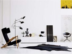 Black, white and yellow: nice hanging sculpture at the back and original locust-like chair