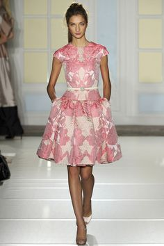 Temperley London. Like the style. Undecided about the color. Confused about the different colored shoes.......