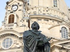 statue of Martin Luther in front of the rebuilt Frauenkirche (Church of Our Lady) in Dresden (Germany)