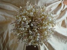 Items similar to Wedding bouquet in ivory and dusky pink with pale pink diamante flowers ivory pearls and pale pink seed bead 'leaves' wrapped in ivoryribbon on Etsy Christmas Wedding Flowers, Ivory Pearl, Bridal Style, Pale Pink, Wedding Bouquets, Seed Beads, Pearls, Bridal Fashion, Eve