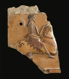 Phrygian or Lydian fragmentary terracotta architectural plaque, Asia minor, 550-530 B.C. Molded with a horseman riding to the right, with red and black painted details, the upper and lower border painted as well, pierced, 29.2 cm high- Private collection
