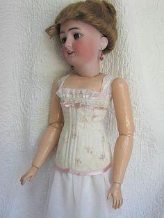 Antique Simon & Halbig 1159 in corset sewn from antique silk.
