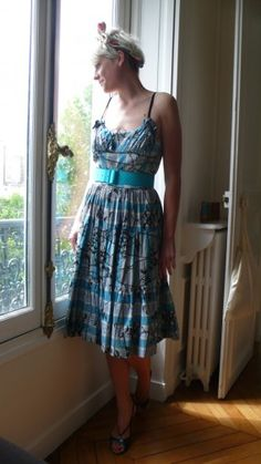 """I got this 1950's sun dress at Portobello Market in London. The shoes are Michel Vivien from Paris."""