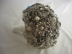 Bridal bouquet made from vintage and second hand brooches, buttons, earrings and other trinkets.  Just beautiful