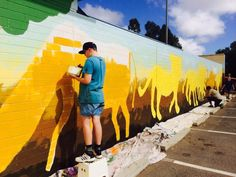 Children at Pom Pom working with artist James Dodd on a mural for National Youth Week 2015.