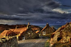 An Gearrannan - The Black House Village on the Isle of Lewis. I am captivated by this photograph as I am always affected by how dramatic the skies can be in the Outer Hebrides! Great Places, Beautiful Places, Places To Visit, Places Around The World, Around The Worlds, Highland Village, England Ireland, Outer Hebrides, Chula