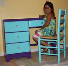 bought this desk on craigslist...it was scratched up and had stickers and flowers painted on... I painted it blue and purple for my daughter, and she loves it!!