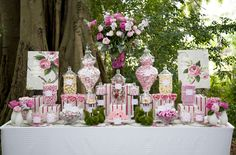 Pink and White candy buffet - Too cute with the outdoor setting and the little squirrel figurines.