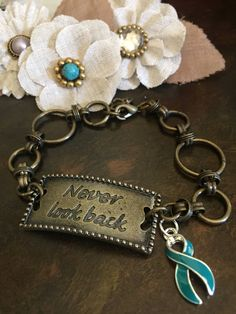 Teal Ribbon Never Look Back Bracelet - Ovarian Cancer Survivor / Awareness Jewelry / PTSD / Martin Bell / Anxiety Disorder by RockYourCauseJewelry on Etsy