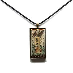 This pendant features a historic Italian print of The Tower tarot card. The original Italian color scheme of oranges and blues is highlighted by two borders of Swarovski crystals and encased in an antiqued bronze bezel.Dimensions: 48x24mm. $59.99 #Tarot #TarotCard #Jewelry