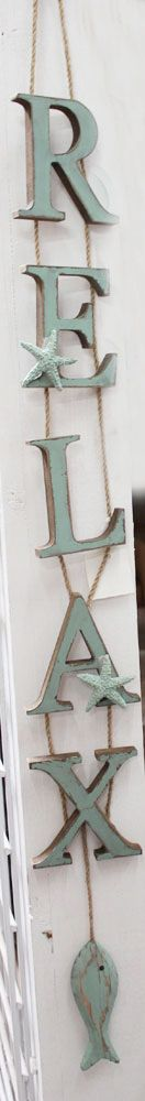 Vertical Hanging Wood Signs -  can make your own with letters from craft store or Walmart, small rope and paint :)