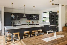 A large kitchen island in a Shaker kitchen.