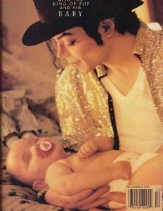 Michael Jackson~ Holding one of his babies~ You can't hardly beat that photograph!!