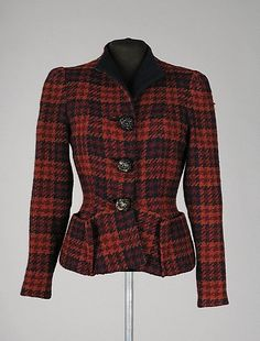 A beautifully tailored tweed jacket from Elsa Schiaparelli's Fall-Winter 1936-1937 collection.