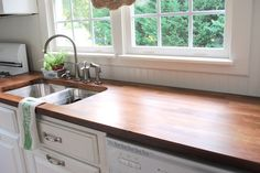 butcher block counter with beadboard backsplash