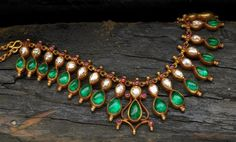 Emerald, diamond, ruby and gold necklace.