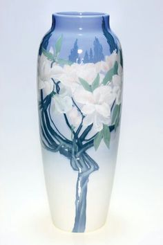 ~Rookwood~Artist: John Dee Wareham~Circa 1902~White Clematis Flowers On Thick Gnarly Vines Above Which Are The Tops Of Tall Evergreens-Iris Glazed Scenic Vase~