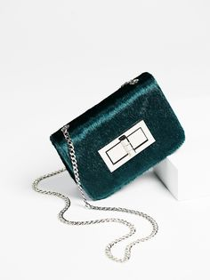 Prospect Vegan Crossbody | Chic vegan leather crossbody with a simple design. Features a large front twist lock detail and a classic chain strap. Lined inner with small compartments for storing.