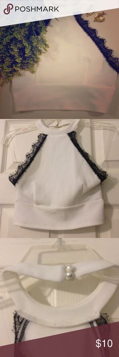 White Backless Crop Top with Black Lace Trimming👛 White Backless Crop Top with Black Lace Trimming. Very sexy!! Can't wear bra with this. Can dress up with heels or down with flats or wedges 👠🌸☀️ Manito Tops Crop Tops