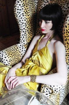 Yellow gown, leopard chair. Perfect.
