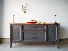 Martha Leone Design. A Bassett buffet is painted with antiquity in mind. Custom gray.