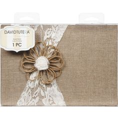 Capture and preserve the personal sentiments of your special day with this sweet lace and burlap guestbook touched off by a cute hemp cord flower.  Provide your guests with a variety of pens so they c